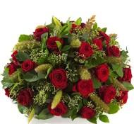 Rouwstuk met rode rozen